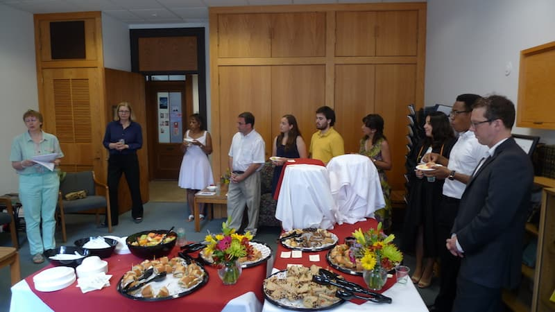 A group of people standing at event in German Studies lounge